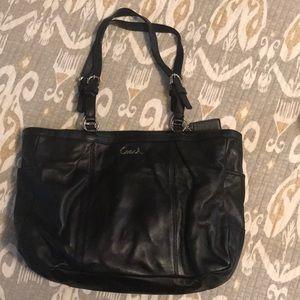 Black leather Coach purse.